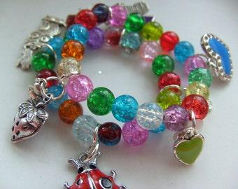 Two Childrens ,  charm Bracelet, ladybug, watermelon, teddy, etc, by NewellsJewels on etsy
