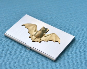 silver tone business card case with brass bat