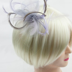 Silver grey fascinator with accent colour of lilac. On a clip, comb or Alice band