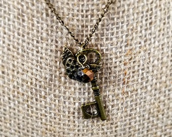 Brass key and heart charm necklace