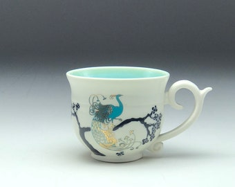 Fancy handle tea cup, ceramic teacup, wheel thrown pottery, art nouveau peacock, gold decal, hand thrown mug, black Aqua white, Anja Bartels