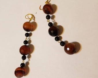 Tigerey gemstone beads. Black onix . Gold plated ears