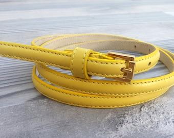 Women's leather belt. Yellow