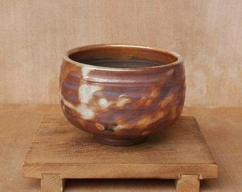 Wood fired stoneware tea bowl (chawan) with golden shino glaze