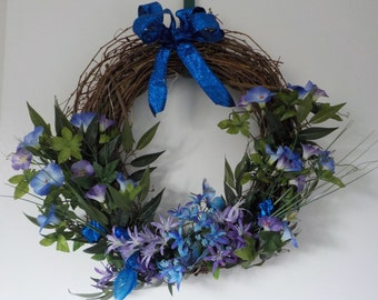 """18"""" wreath with blue and purple flower and lights"""
