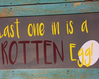 """Chicken coop sign. """"Last one in is a rotten egg."""""""