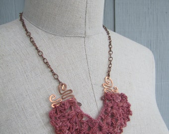 Statement necklace in dusky pink wool with copper wire-work