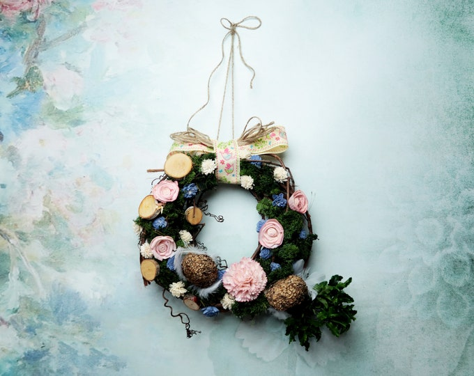 Natural colorful spring floral wreath Easter door decoration pink blue green preserved greenery moss wicker wood slices sola flowers twine