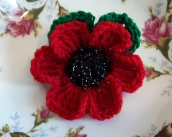 Crochet poppy flower brooch leaves and fluffy middle corsage pin Remembrance Day