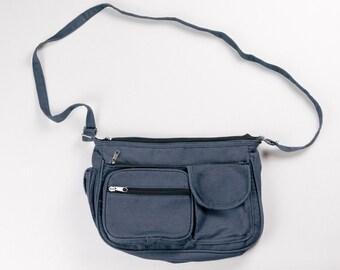 Simple vintage 1990s blue dark denim like color way multi zipper shoulder pouch bag. Multiple compartments