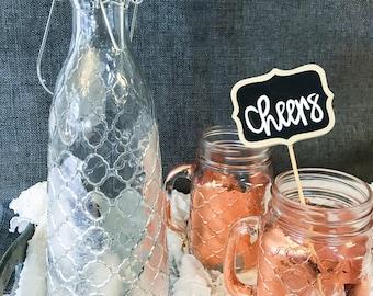 Ornate decanter-- drink pitcher, foil finish, silver