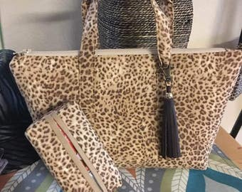 SALE :was 25.00 now 20.00...Darling Animal Print makeup / Travel bag.   Hand wash, Quilted for softness and durability.