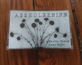 "ASSHOLEKNIFE, ""Nuclear Family Game Night,"" an experimental doomy space noise album on cassette"