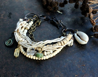 Light bracelet with spiral charm, rustic natural bracelet, Bronze Age amulet, bohemian charm bracelet, off-white cowry fertility bracelet