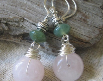 pink , green, and silver dangle earrings