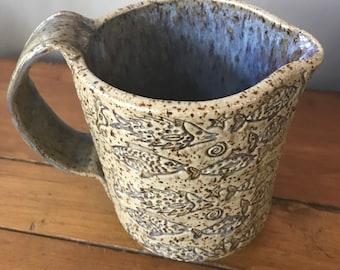 Handmade pottery creamer pitcher w/ fish pattern