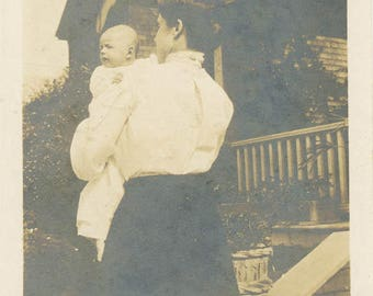 Vintage photo 1915 Abstract Mother From Back Holding Baby