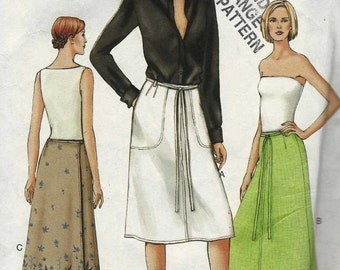 Vogue 7590 A-line wrap skirt with tie ends optional pockets knee or calf length Size 12-14-16 uncut sewing pattern