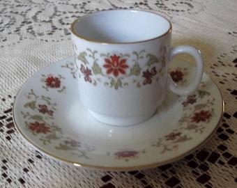 Fine porcelain demitasse cup and saucer