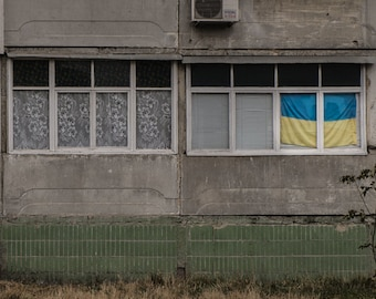 Four Windows and Ukrainian Flag in Sumy- a color photograph