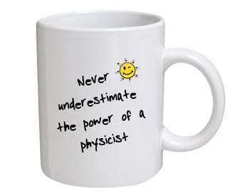 Never underestimate the power of a physicist - novelty mug for a physics, science, teacher or student, science geek and others.