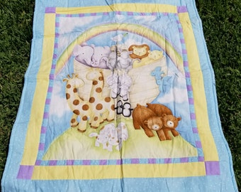 Noah's Ark Quilt with animals and rainbow.