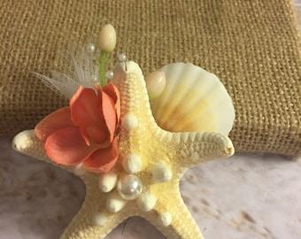 Beach wedding sea shell boutonniere