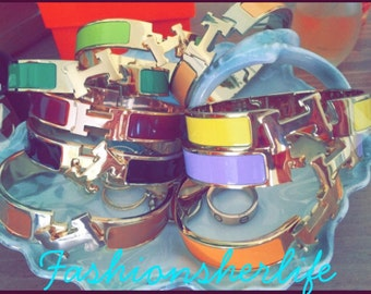 """Hermès Clic Clac """"H"""" bracelet All colors Gold/Silver trim Adorable"""