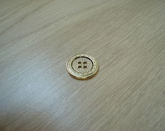 button round gold tone metal with several decor
