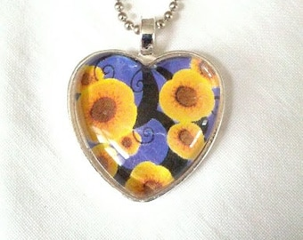Cobalt Blue and Sunny Yellow Floral Glass Heart Pendant. Lovingly Handmade in Brooklyn by Wishing Well Studio.