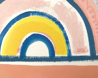 Peach skies! Blue, yellow, pink rainbow
