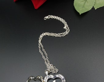 Silver necklace with heart-toothbrush. Necklace heard.