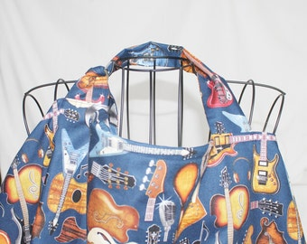 Deluxe Guitars on Navy Nursing Cover