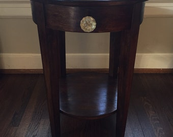 Newly Refinished Round side table with antique knob pull