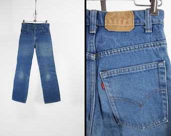 Vintage Levi's Jeans Red Tab Faded Made in USA Distressed Denim - 27 x 28