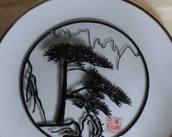 Anhui Wuhu traditional Chinese handmade iron art / artwork on plate background