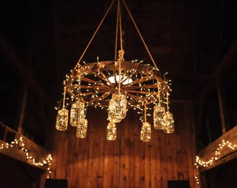Antique wagon wheel etsy wagon wheel chandelier mozeypictures Image collections