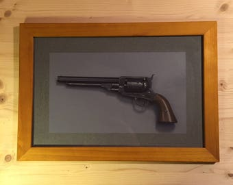 Wooden frame with Western firearm