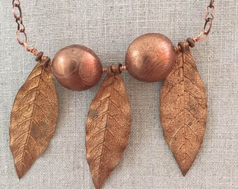 CHLOE:  Necklace with handmade copper lentil-shaped beads and copper leaf pendants