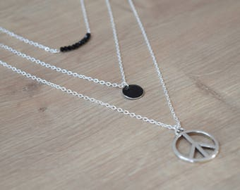 Silver multi strand peace necklace