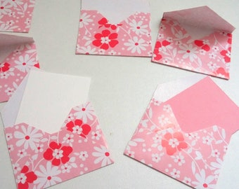 Set of small flowers pink envelopes