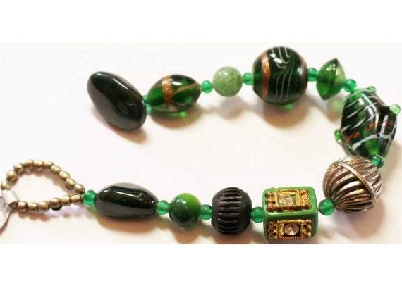 A Nice Vintage Boho Tribal Green & Gold Art Glass Beaded Bracelet with Toggle Clasp