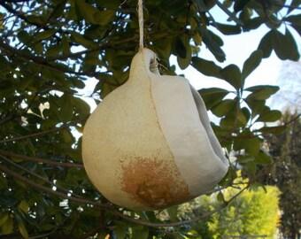 Matte green ceramic bird feeder