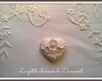 Decorative plaster heart Cherub