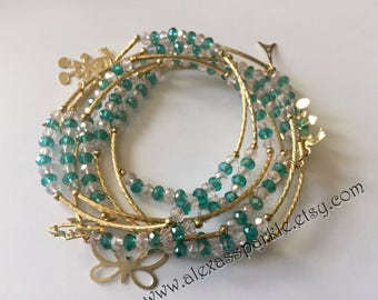 Clear and Teal bracelets with gold plated charms - Semanario combinacion cristal y  azul verde con dijes de chapa de oro