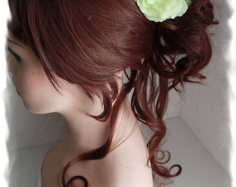 Tender Camellia lime bridal hairstyle with white feathers and swarovski crystal faceted heart
