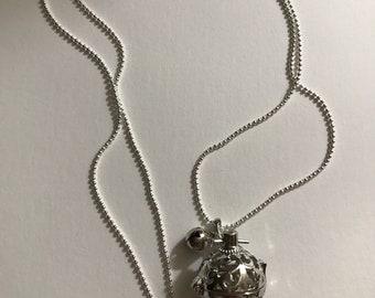 Pregnancy bola silver necklace.