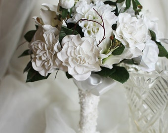 Ellie - Traditional Bride Bridesmaid bouquet.  Real touch and soft touch flowers.  Gardenias, roses and lilies, dahlias.  All white bouquet.