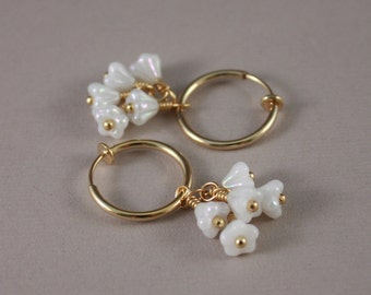 Clip on earrings, gold-plated hoops, with Czech glass bell flowers white luster