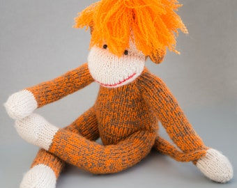 Knitted monkey toy handmade orange wavy hair magnificent hairstyle